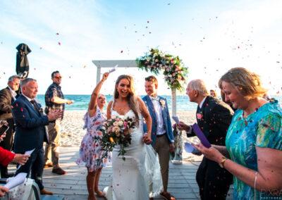 Happy couple's wedding at The Sandbar Beach Cafe
