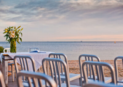 Chairs set up The Sandbar Beach Cafe