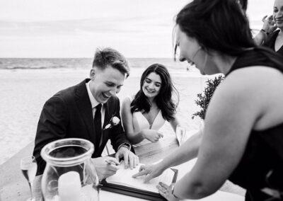Bride and Groom signing at their wedding at The Sandbar Beach Cafe