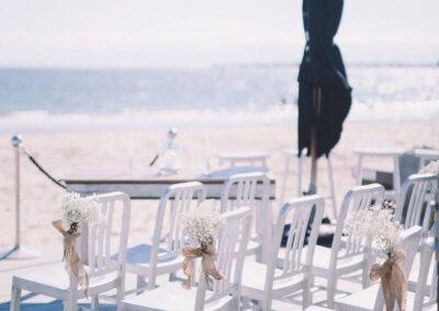 Chairs on the deck set up The Sandbar Beach Cafe